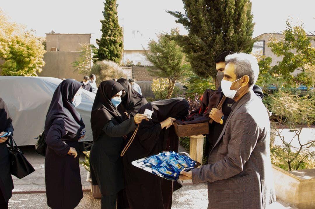 مراسم استقبال از پرچم گنبد مطهر حضرت امام حسین علیه السلام در مخابرات منطقه کرمانشاه